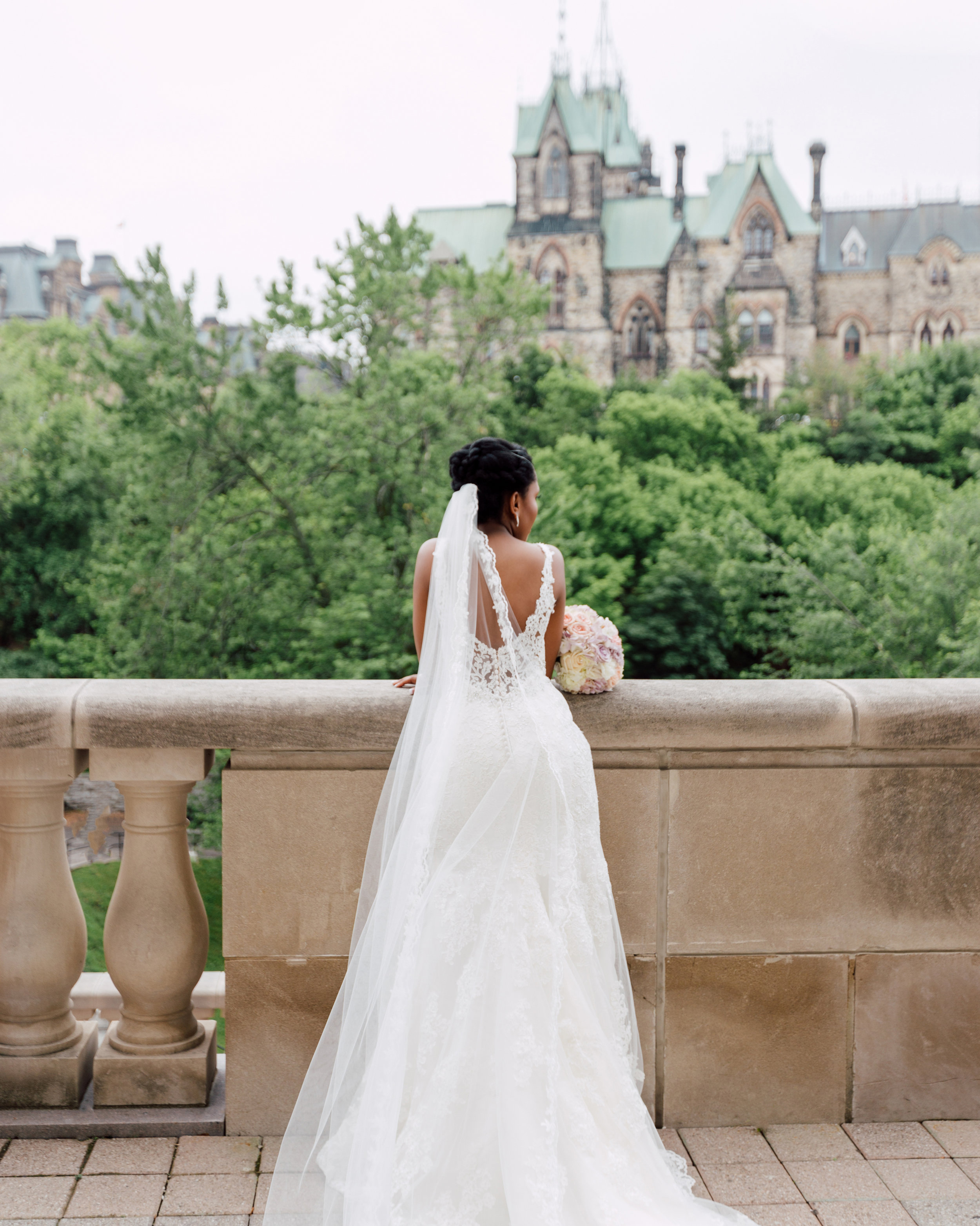 Bride waiting for groom at here castle in canada for wedding photography