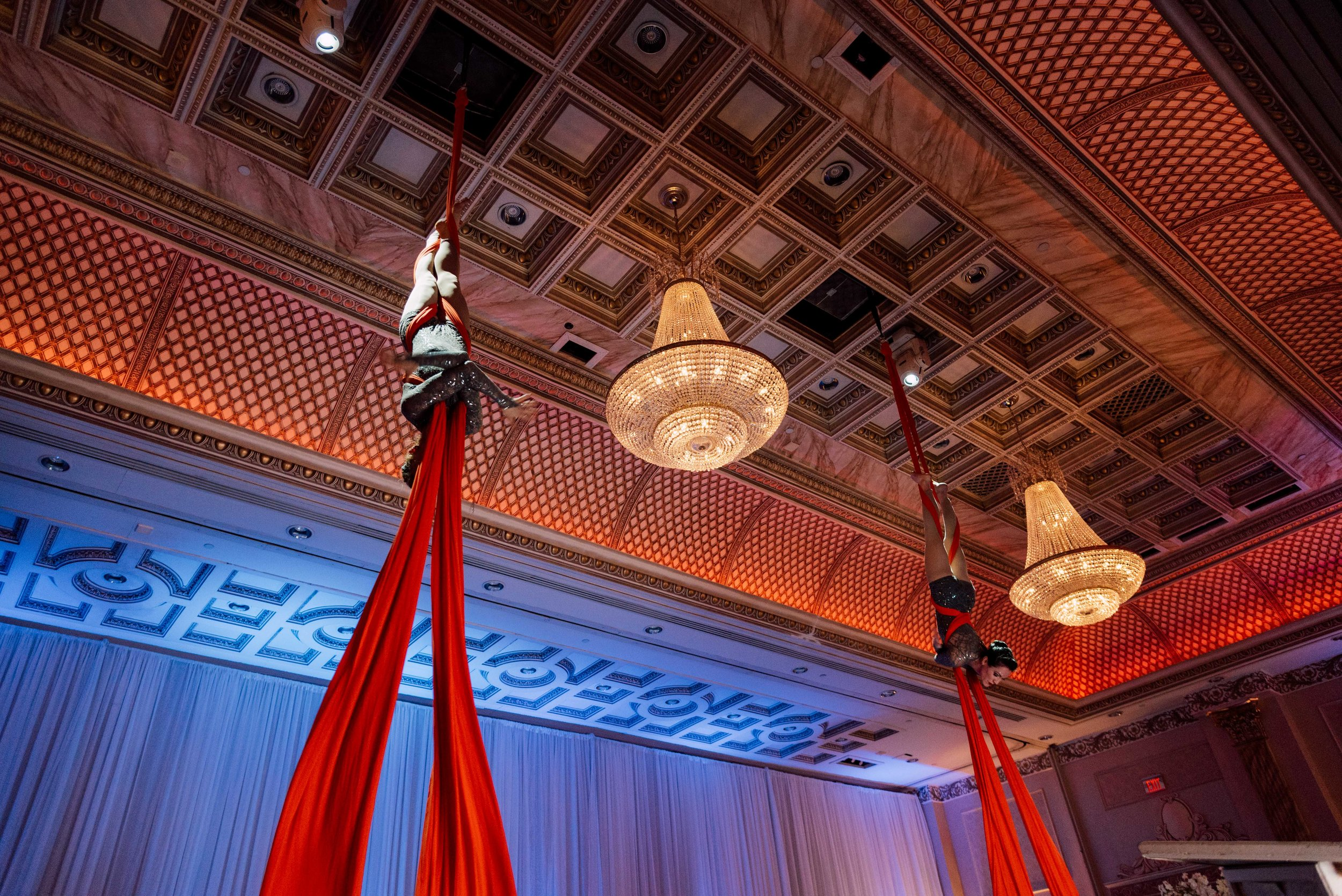 aerialist hanging Special event photography at chateau le jardin in woodbridge ontario