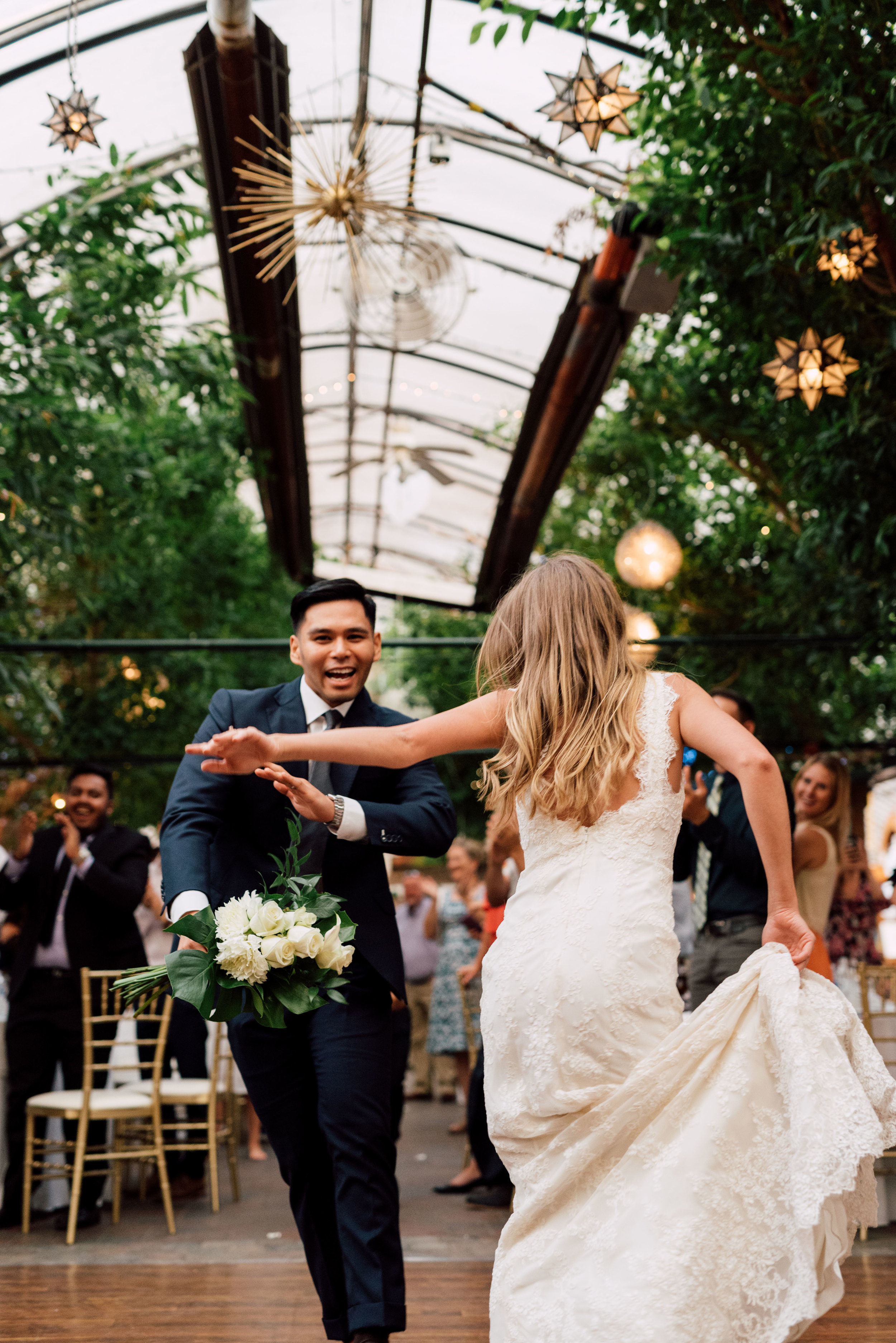 Introducing the wedding party and couple to the dance floor at madsens greenhouse