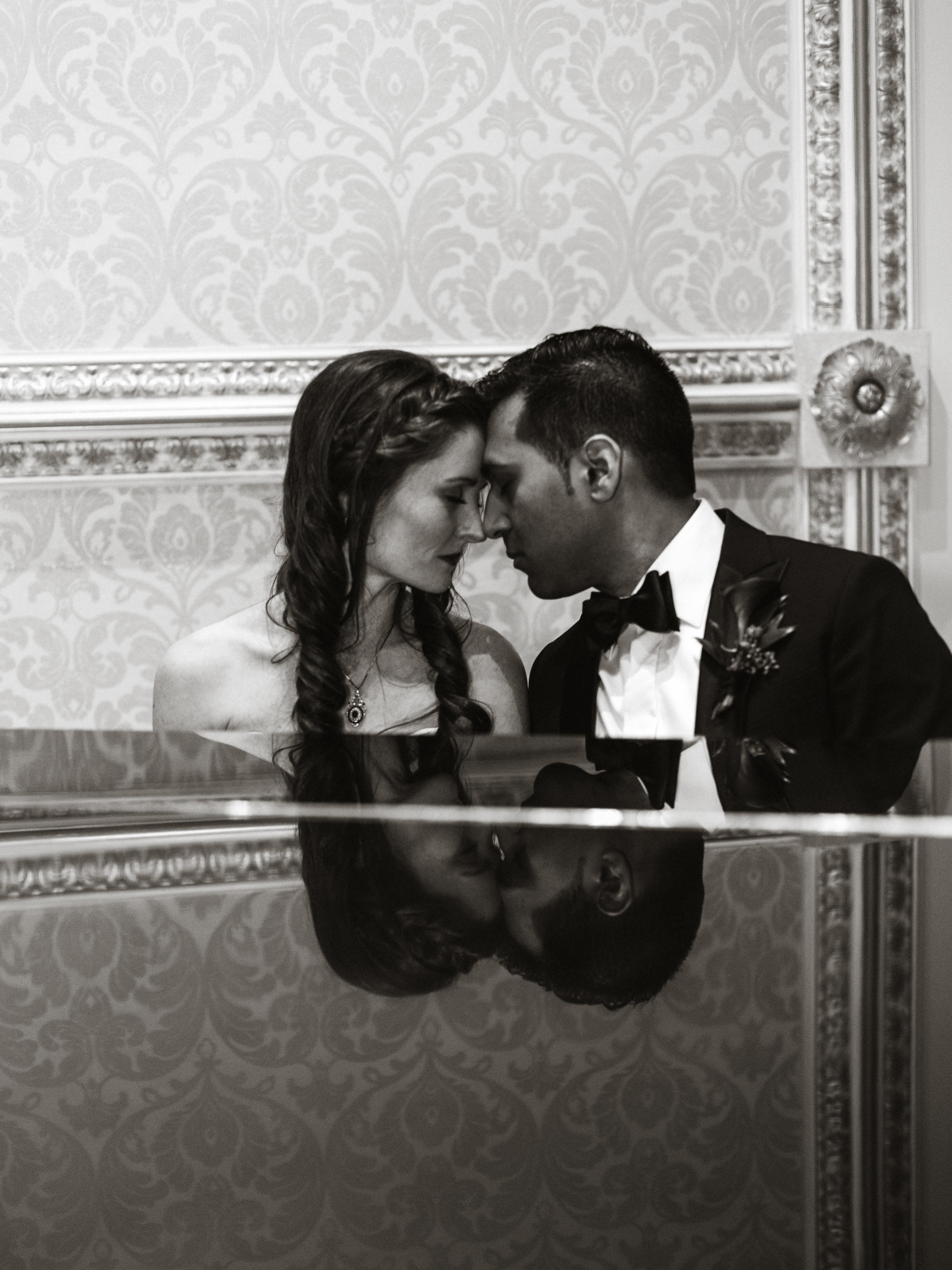 Reflection of couple sitting at a piano at a toronto wedding