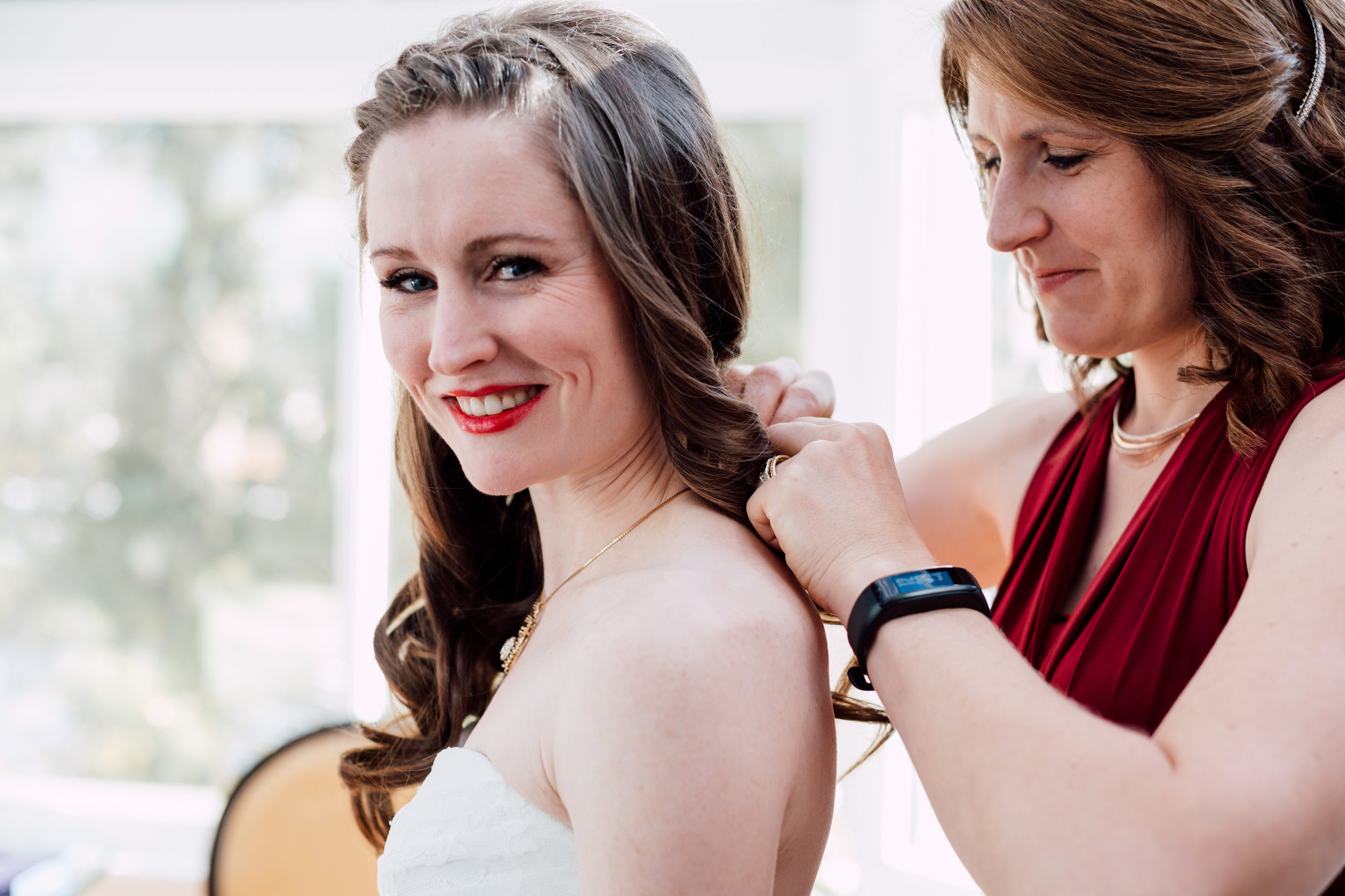 Bride having necklace put on while getting ready for a wedding in toronto