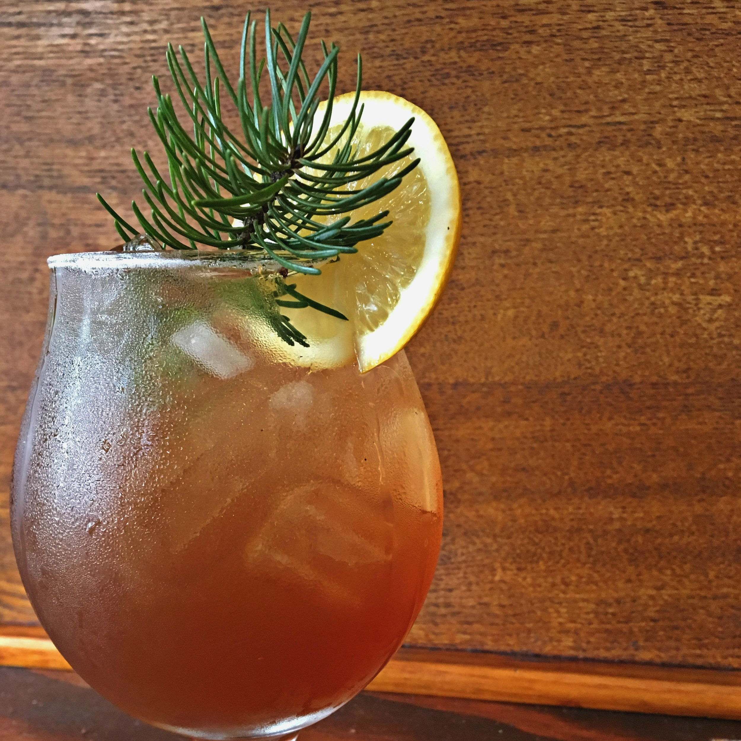 Bilbo Baggins    1½ oz  Aria Gin  ½ oz    Pearl Beverage Co.       Blue Mtn.       Sunshine       Tea Syrup     ½ oz    Pearl Beverage Co.         Lime Twist Tea Syrup     2 dashes  Woodland Bitters from Portland Bitters Project Pour over ice Top with soda water Garnish with lemon and a sprig of Doug Fir