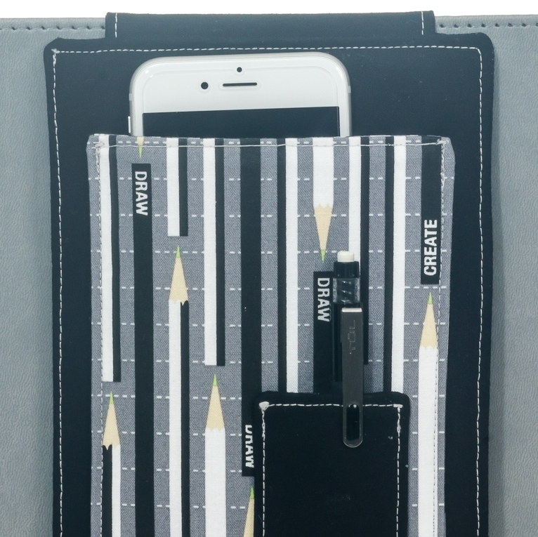 pockets... - slide a phone into the large pocket and 3 pens in the small pocket.