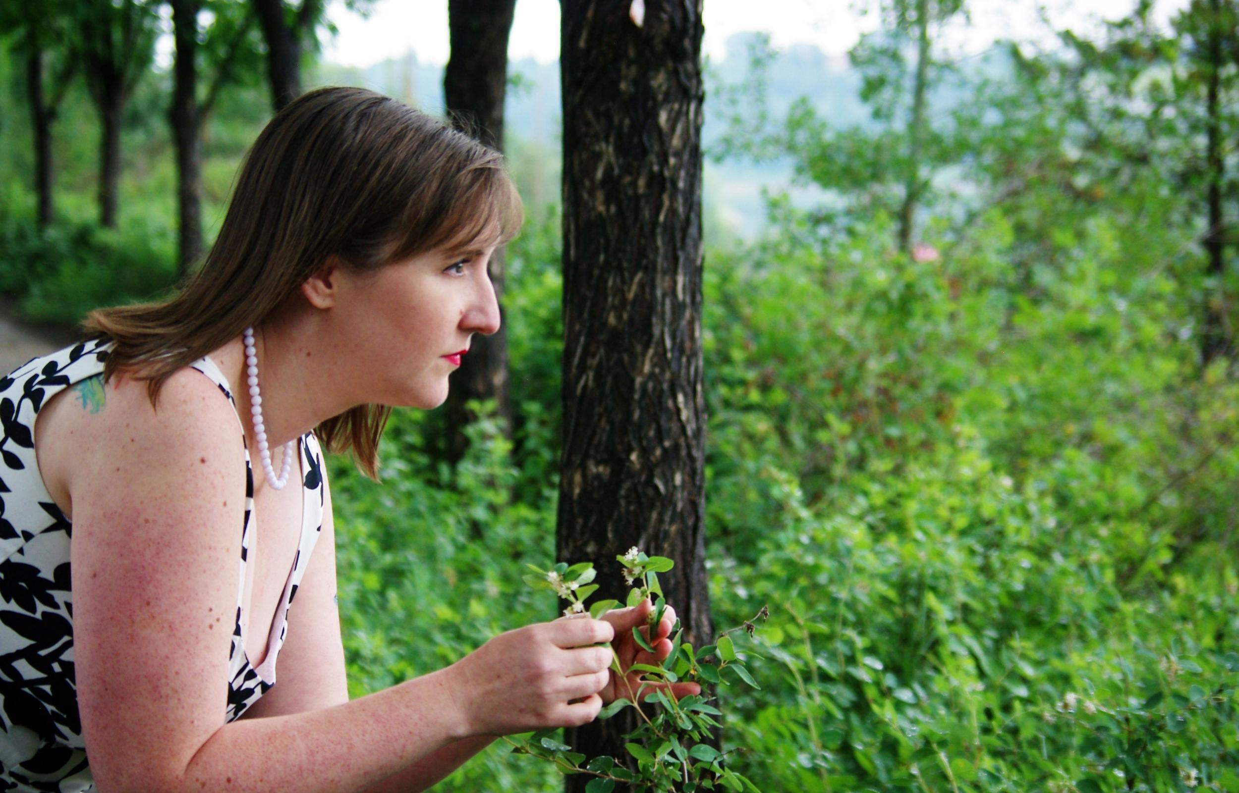 Antoinette picking herbs.jpg