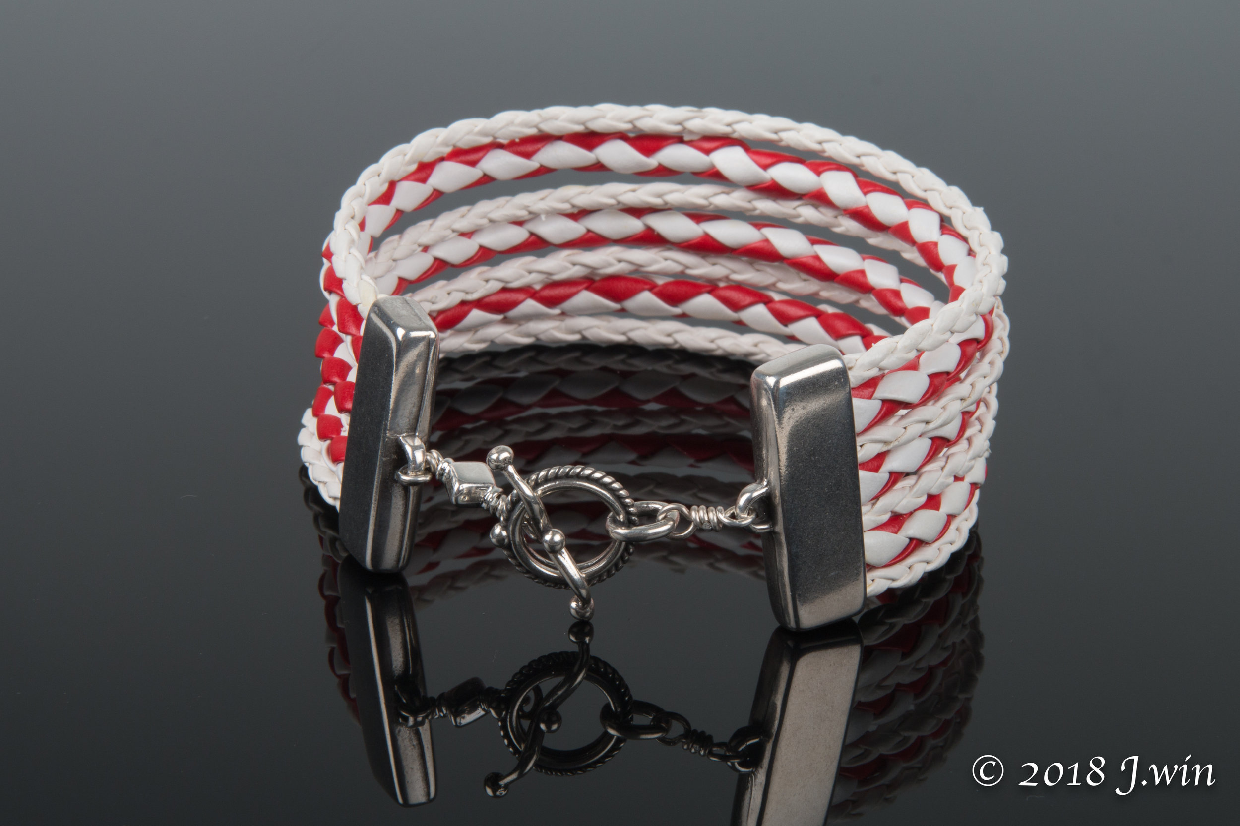 Red and white braided bracelet