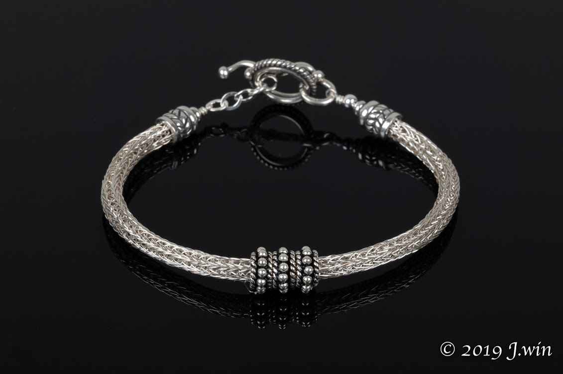 Hand knitted sterling silver bracelet
