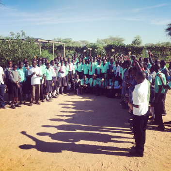 Students celebrate their visit with a cup of fresh moringa tea