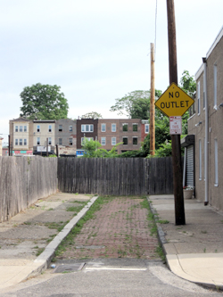 Poplar and Chang Streets, Philadelphia. Which is the better solution, the fence or the sign?