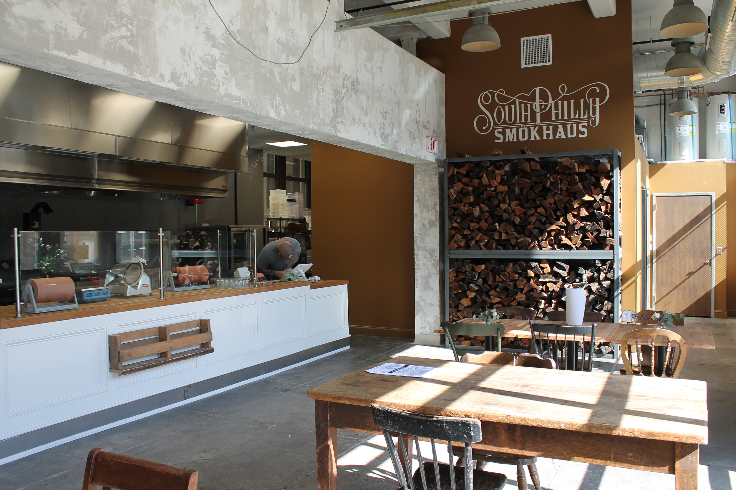 plenty of wood for the in-house smoker! (photo by Bart Bajda / Toner Architects)