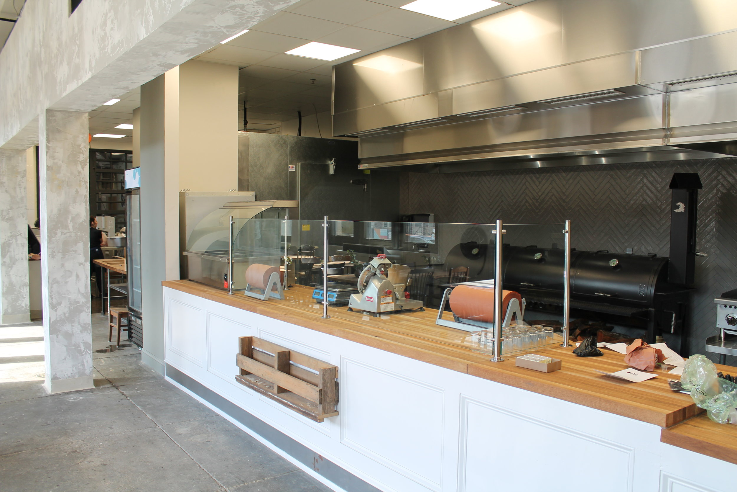 service counter with smoker behind; watch all the action up-close!