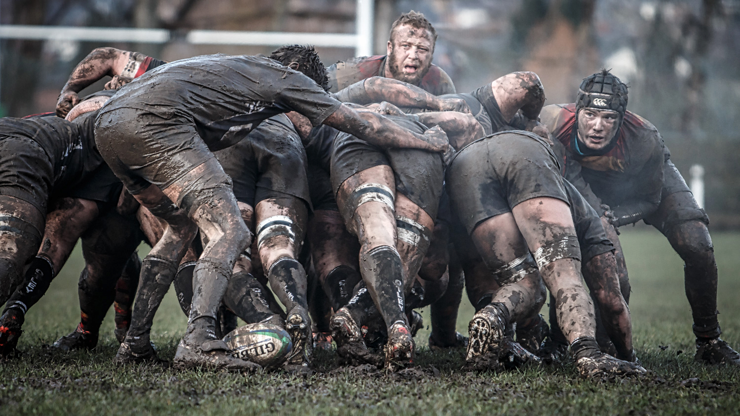 Harrogate's Willem Enslin (left) and Jonny Coser peer round the mudded scrum