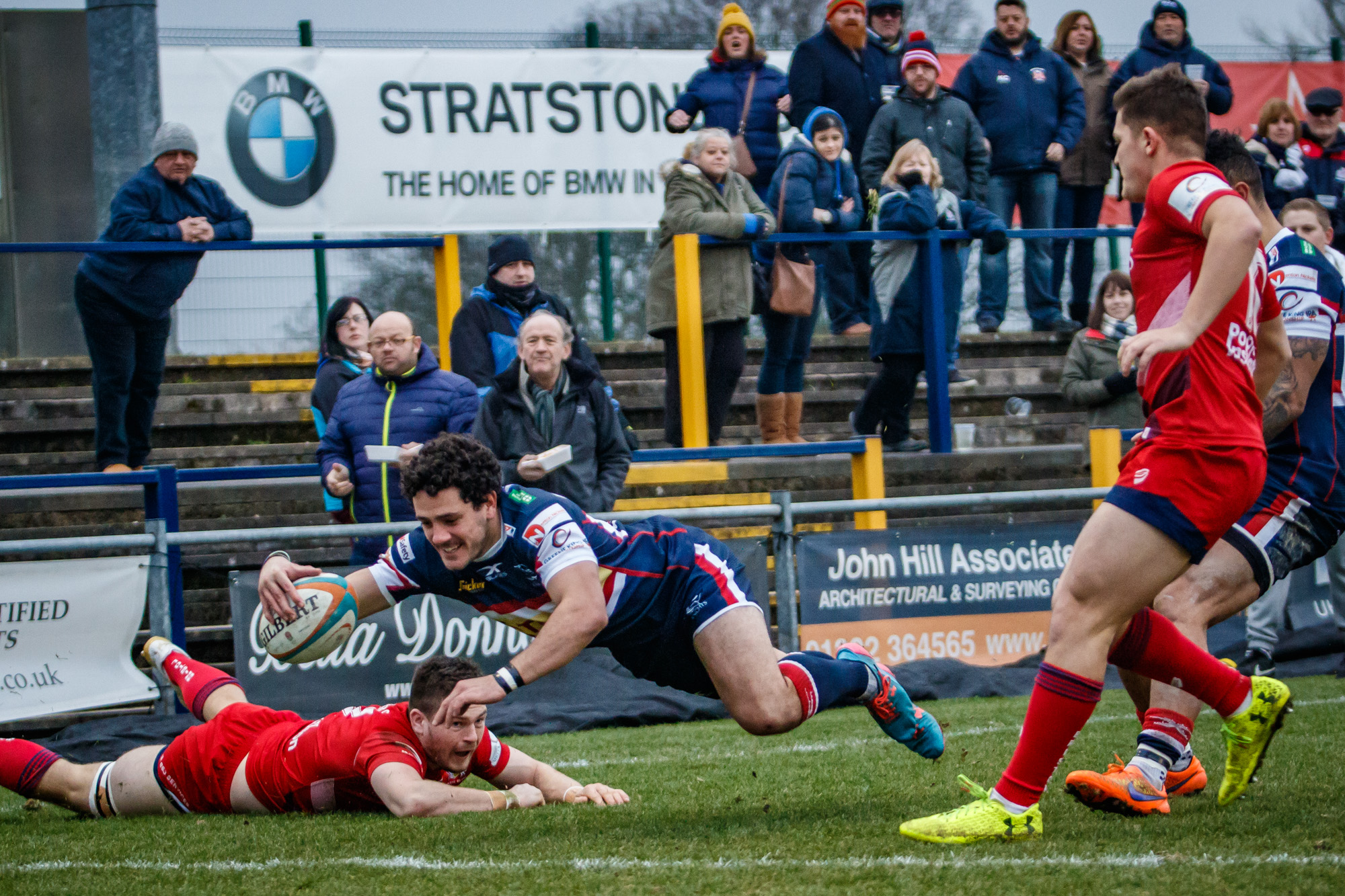 A run,graceful dive and a smile gets Paul Jarvis over the line