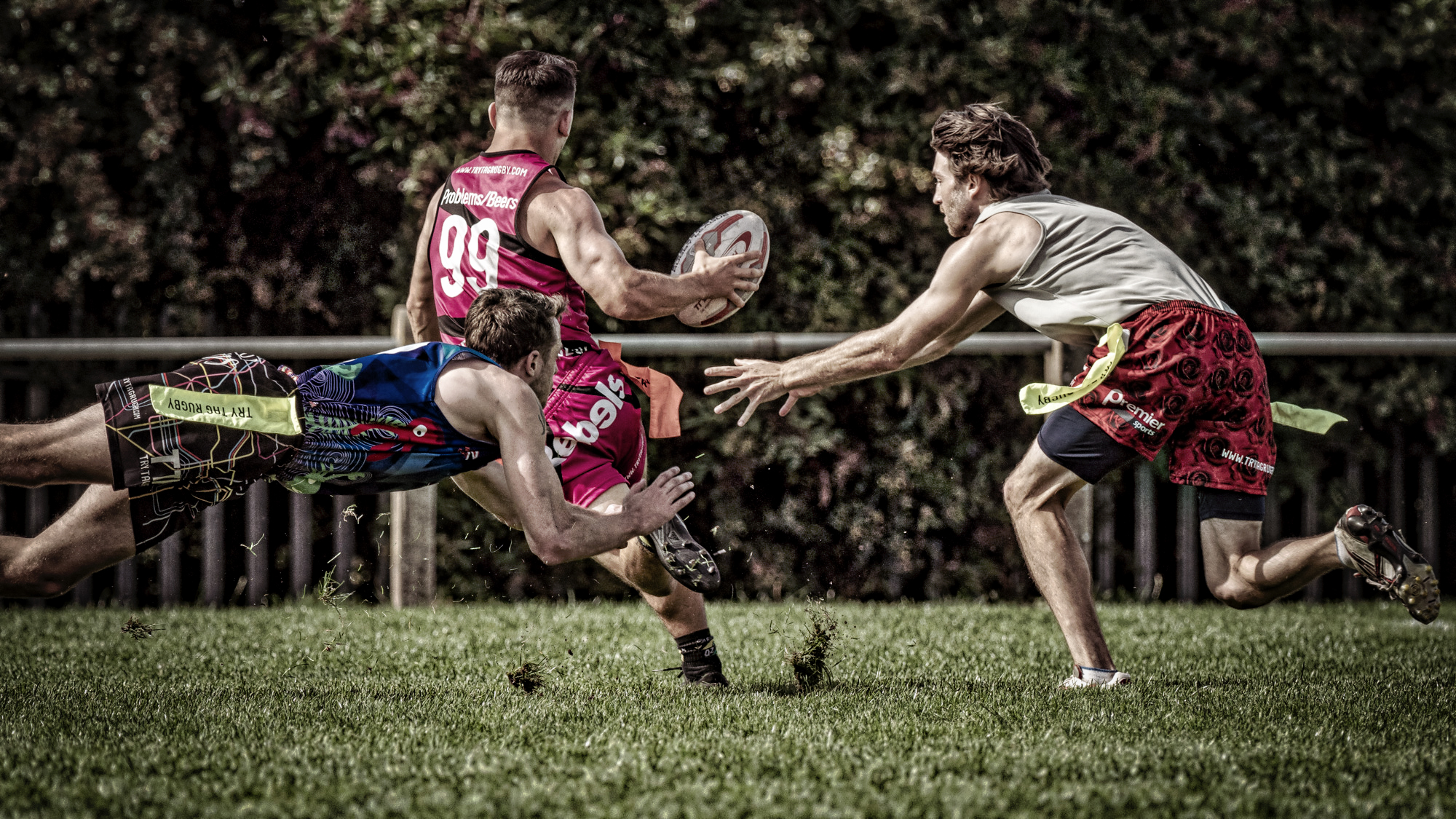 Shouldn't be a favourite sequence as the players are facing away from the camera but I love way the dirt's kicked up and the airborne tackler on the left. Player 99 went on to score.