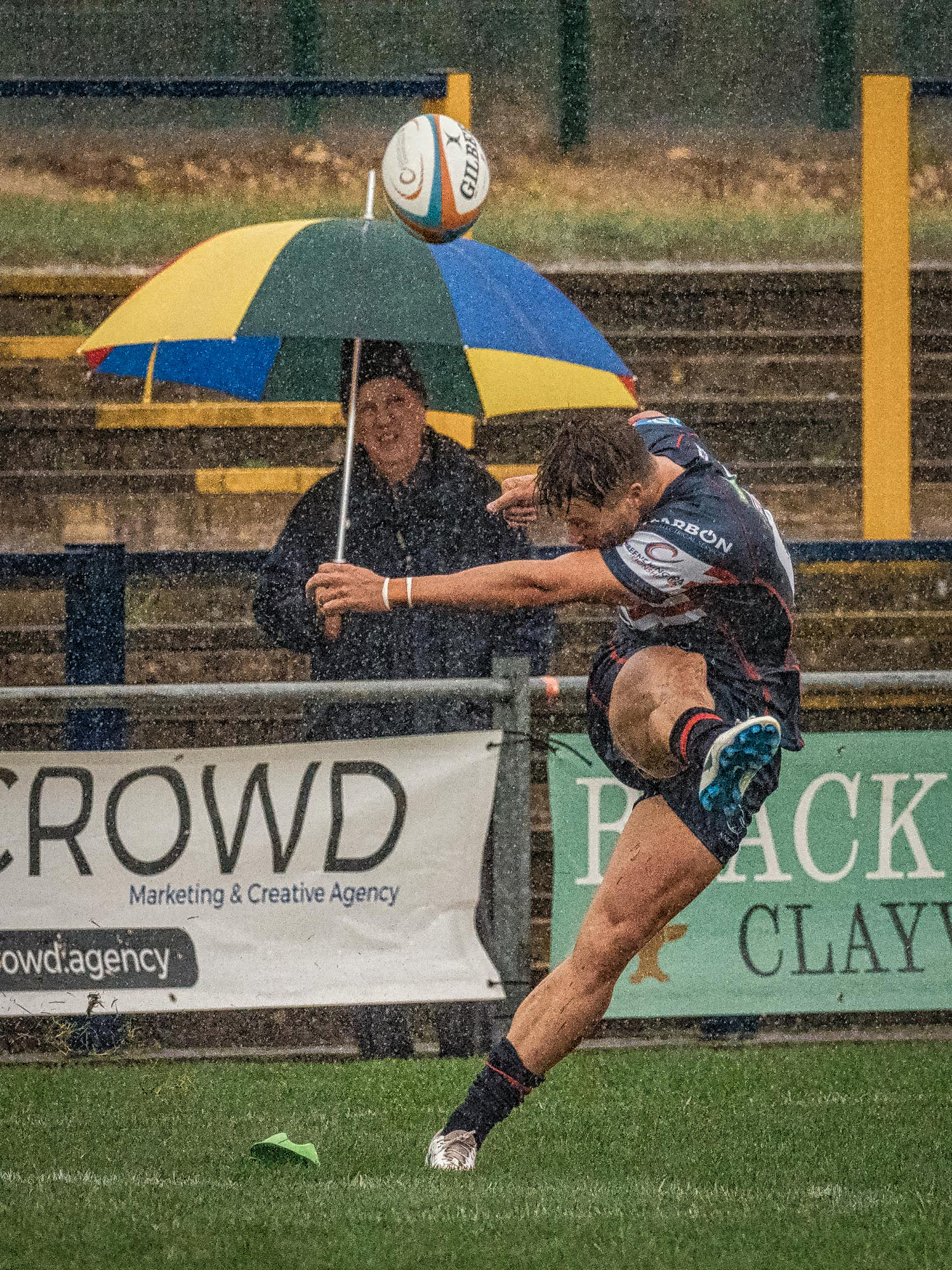 This shot of a late kick shows the strength of the rain in the closing minutes