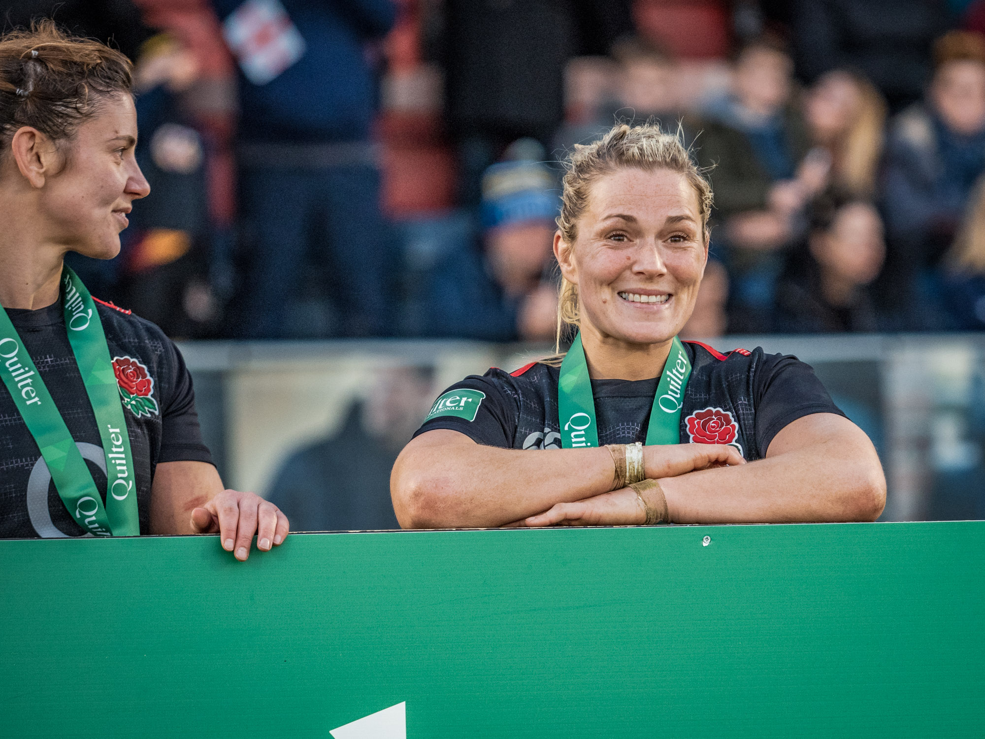 England's Sarah Hunter (left) and Rachael Burford happily wait for the post-match photos