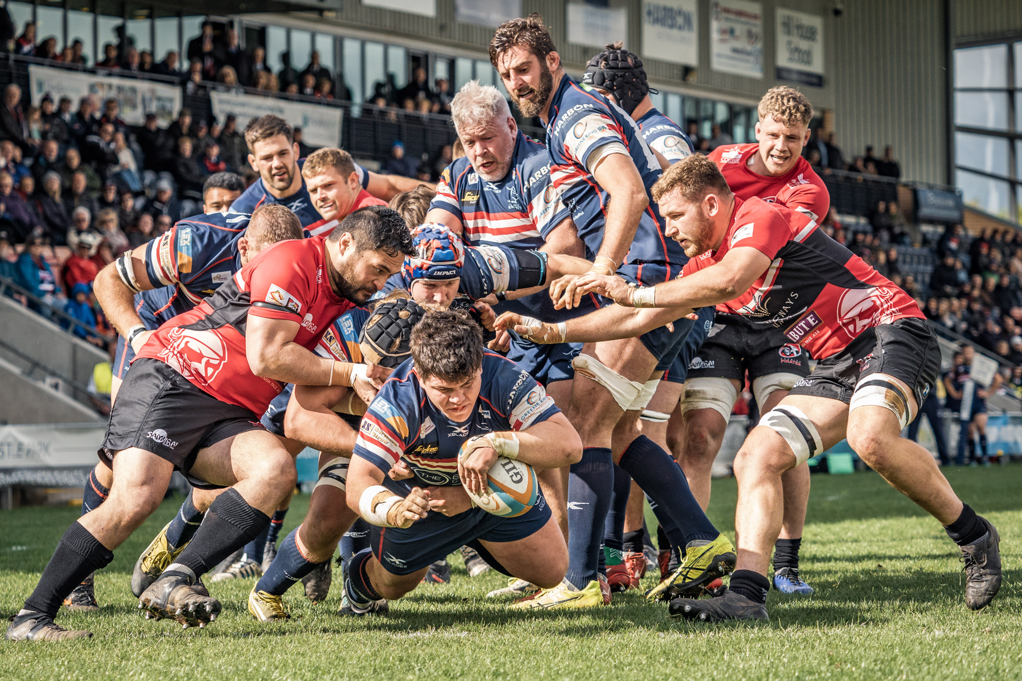 A favourite shot from Doncaster Knights' end of season game with Cornish Pirates. Ben Hunter touches down as others support, resist or watch