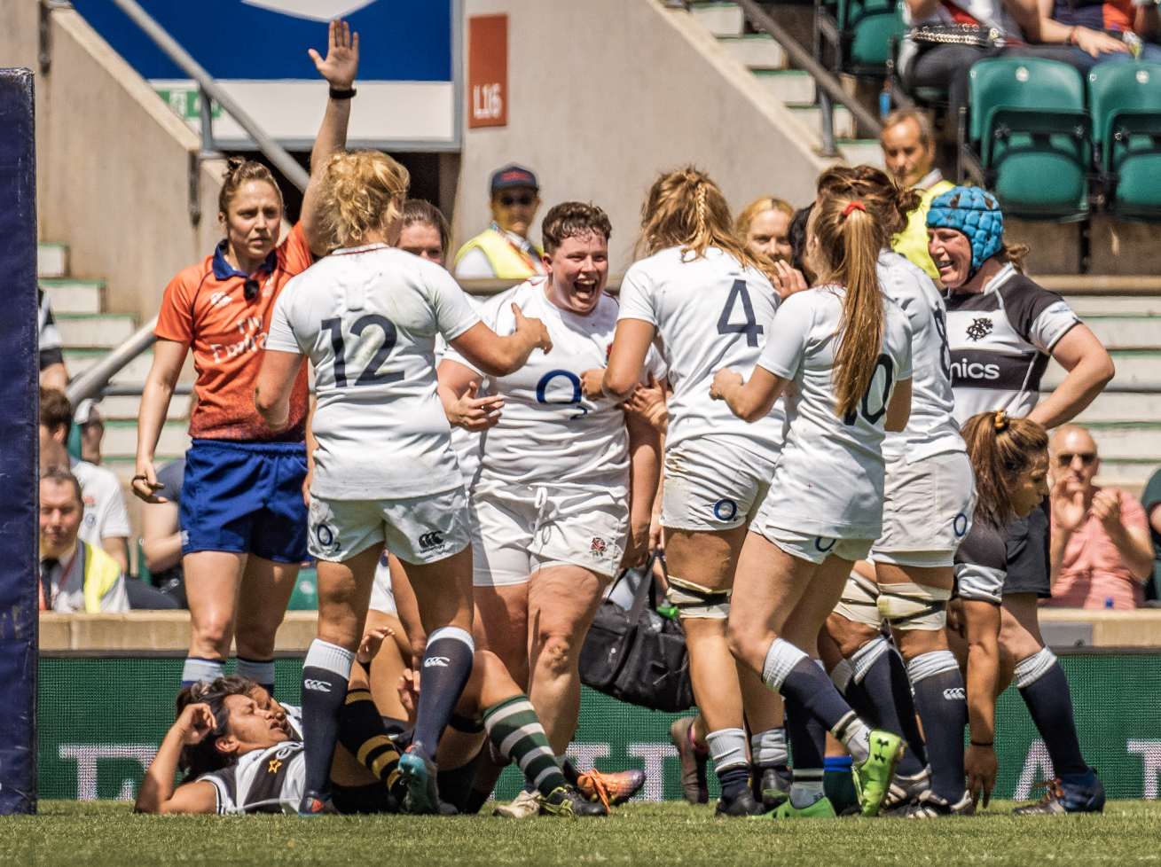 Hannah Botterman celebrates her try while I look on from the other end of the pitch
