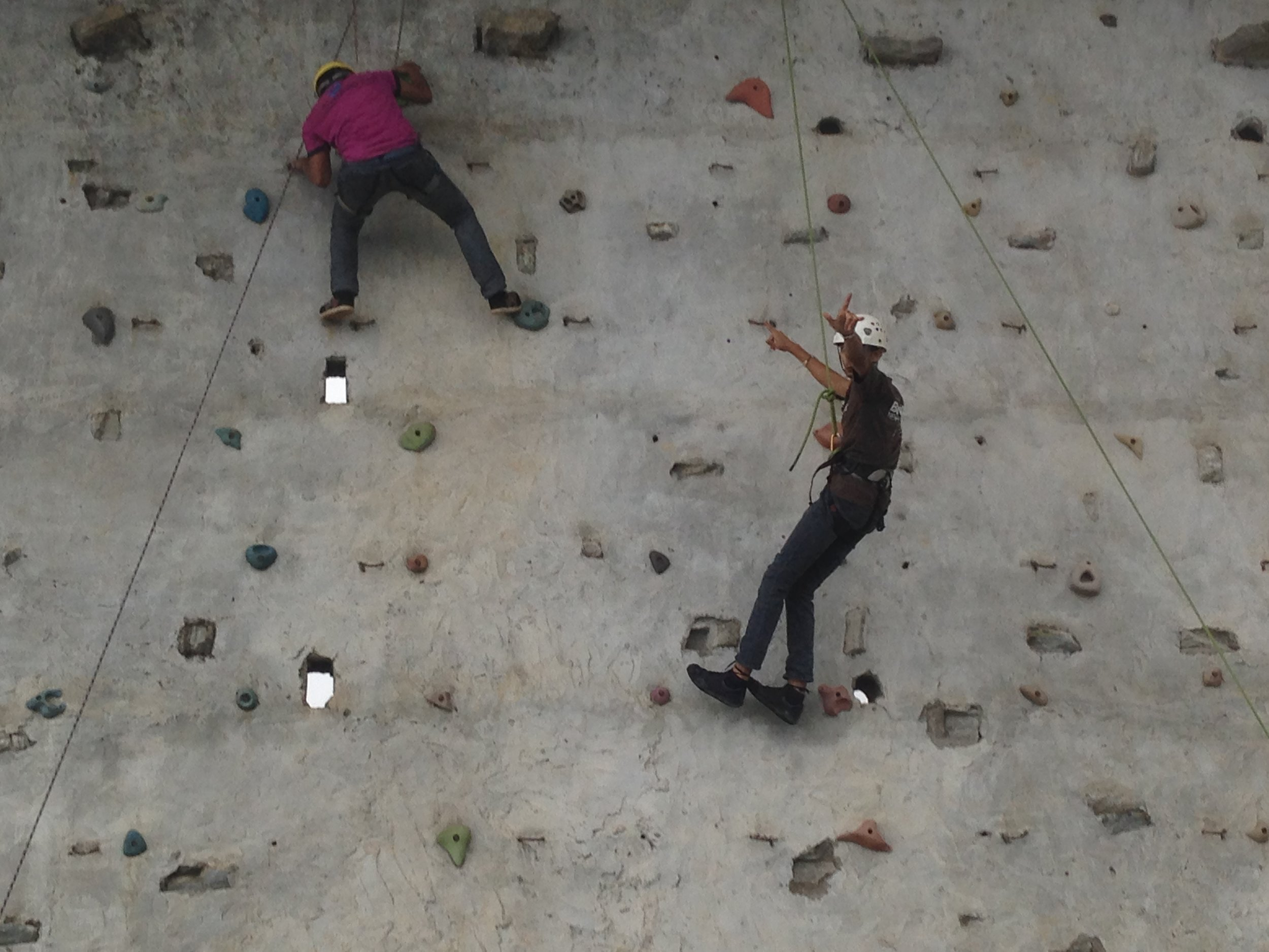 Wall climbing activity that challenged youth to work in teams and reach their physical potential