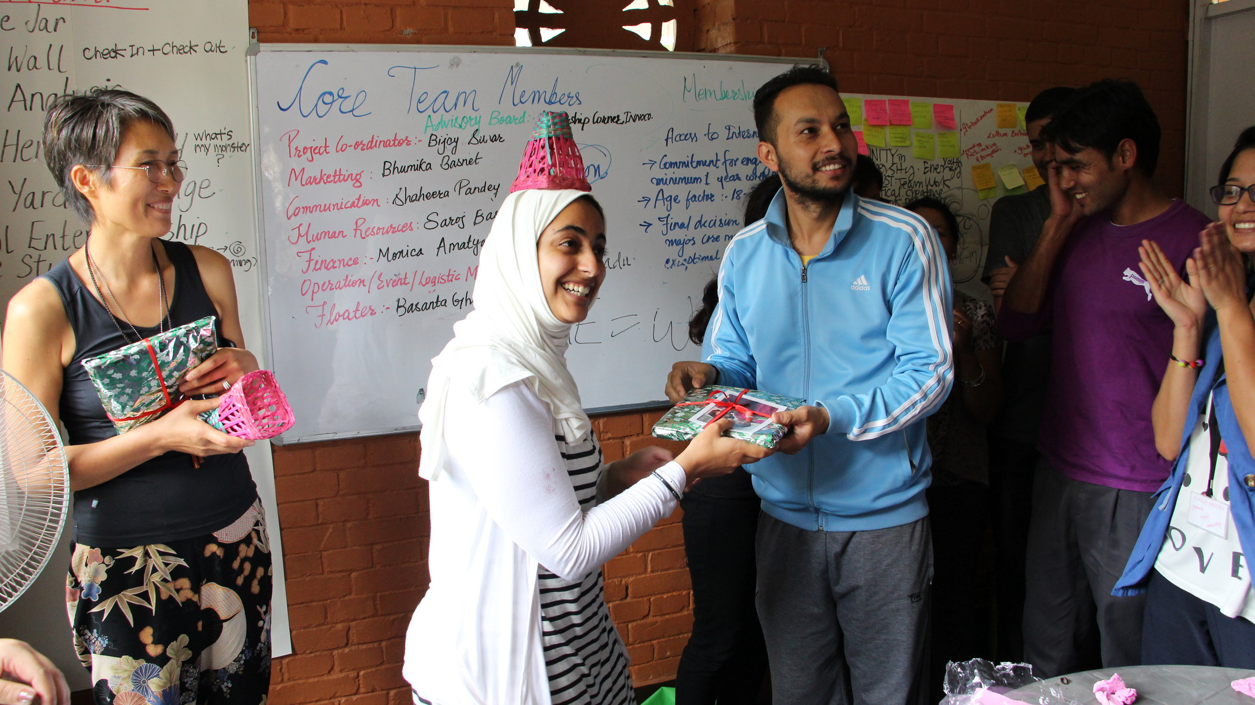 Receiving gifts from the youth participants