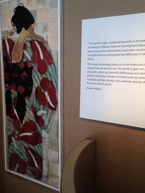"""""""The world is large, varied and beautiful in its diversity."""" Today, Chris is designing a window with an East Asian theme.Randy Feldman, an attorney with an office in the building, donated all the exhibit materials from his personal art collection. Please walk past on Main Street to view these incredible windows."""