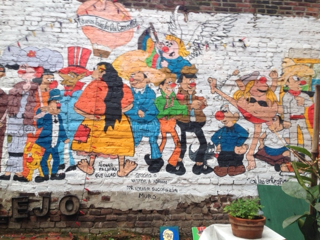 The mural outside on the ledge of the patio of El Kallejon in East Harle