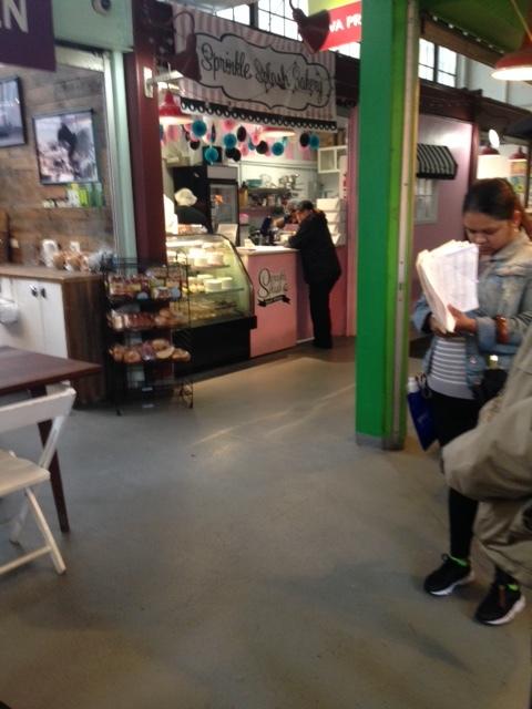 Buying cupcakes in La Marqueta