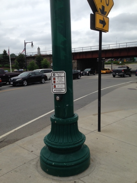 These kind of buttons for pedestrian crossings are the way of the dinosaurs.  Get with the times, Worcester.   Dan suggests we ditch these buttons in the areas we want to be pedestrian rich zones.  Our lights can be on automatic sixty second cycles to give the pedestrians and cars shared turns for movement.