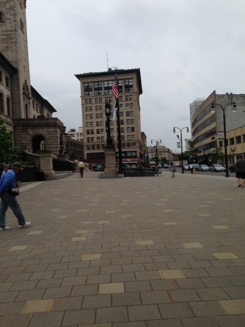 This plaza in front of city hall works well here.  In fact, Dan gave this whole area an A.  We have retail down here, the functions of city hall, this pedestrian plaza, the historic buildings.  This is the heart... right here.  Now, we just have to increase the housing so people are living here and the area does not go to sleep after the workday.  The walkscore is probably high here where we are standing. His suggestion for improvement: The intersection at Main Street and Pleasant Street might be a good candidate for removing the lights altogether to provide shared space use of cars, bikers and walkers.   Look up seven dials in England, he suggested.