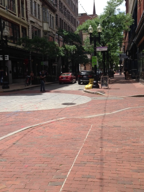 Here's some reasons why we wanted to walk: Check out the great brick lined sidewalks and streets! The white circle of bricks in the center of the street mark off the center of a two main streets. It's just pleasing for the eye. Each building is architecturally unique, historical, fronts up to the sidewalk. Notice the shady, mature street trees as well as the old fashioned light fixtures. There were so many small retail stores, restaurants, cafes, specialty shops, we were not sure what we would find turning the corner. Also, please note the short width of the streets that make room only for one traffic lane and one parking lane.
