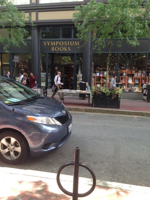 Can you believe what we see? It's a real bookstore, not just another Barnes and Noble. There are tables of books out on the sidewalk to entice readers.