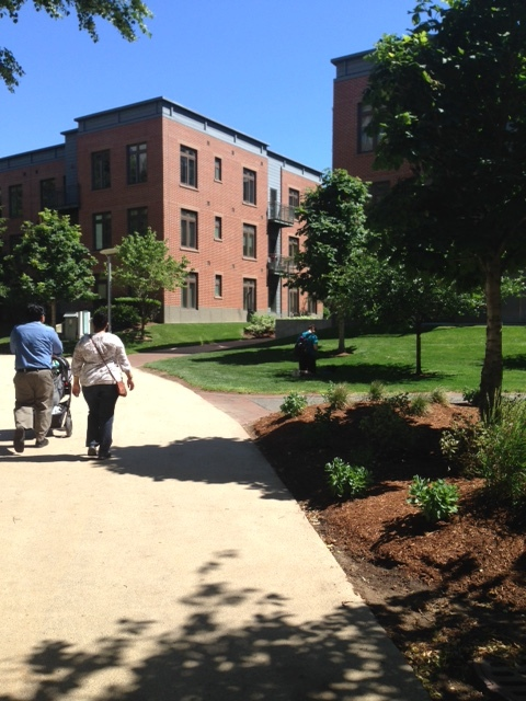Charles River Park is walkable within the interior of the complex. Note the pedestrian walkways adjacent to open space areas with grass, plantings and trees. This complex is primarily composed of large skyscraper residential buildings ringed by outer highways and inner pedestrian corridors.