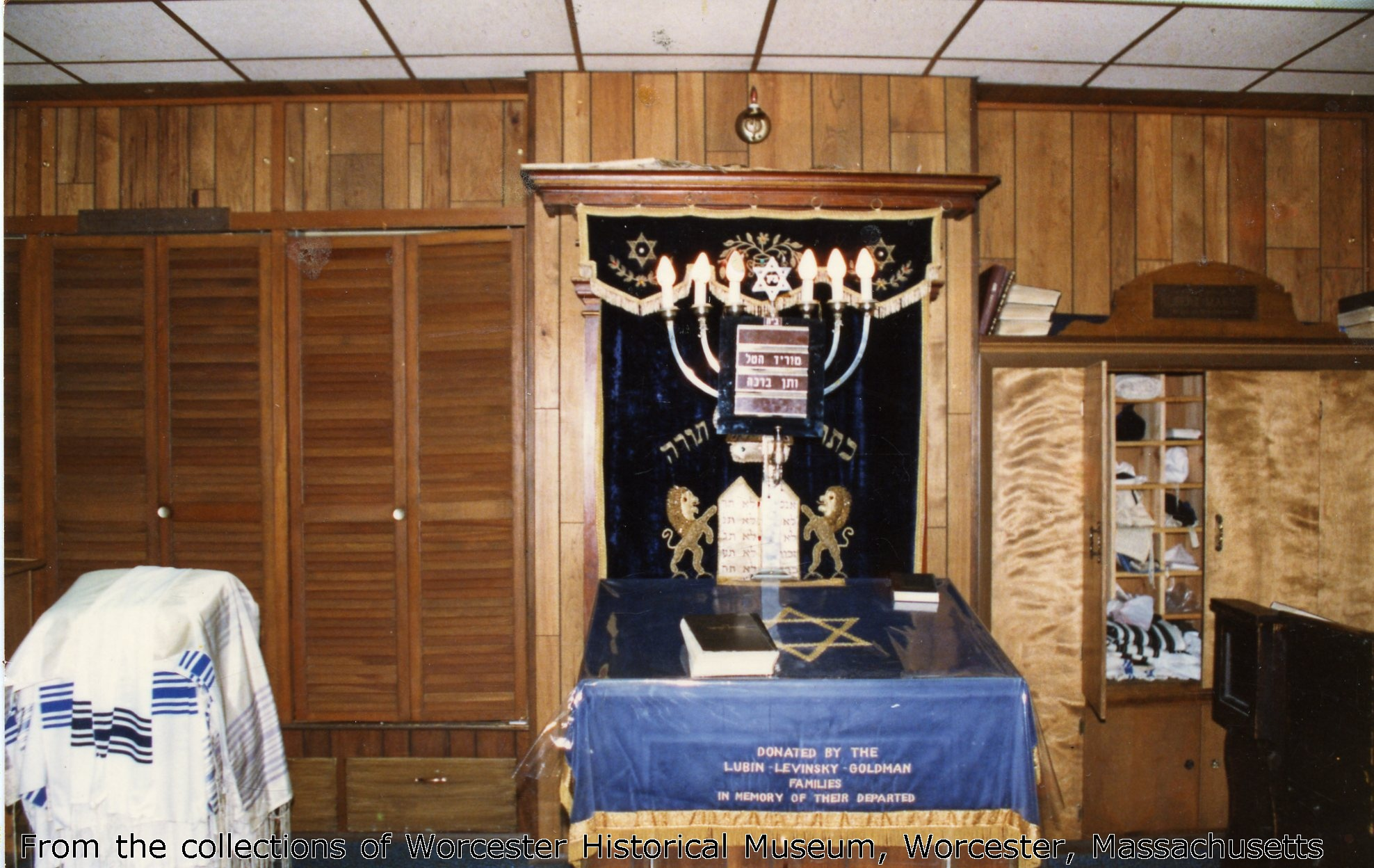 The last minyan no longer prayed in the opulent sanctuary upstairs. They met in this cozy room downstairs converted into a small prayer space. Photo courtesy of Worcester Historical Musuem