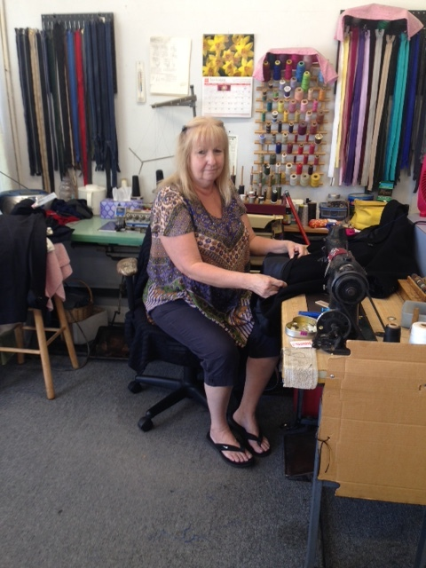 """At the local dry cleaner up the street, Sharon has been hemming our pants and doing our sewing for years now. The manager, Andy, didn't want to be photographed but he has an incredible photographic memory. He knows each customer who walks in the store. I don't even need a receipt. He has my dry cleaning all ready as soon as he sees me on the sidewalk about to enter. This is the """"Cheers-Bar"""" effect, that connected feeling of being in a place where people actually know your name."""