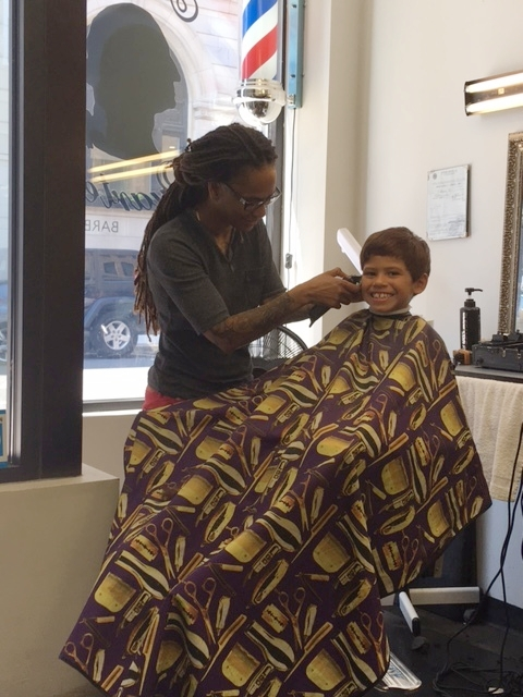 "For the past four years, Jahaira Gomez invested in growing her Head Quarters barbershop on Portland Street.  She will be forced to move in August and believes she may have to relocate to another city that is supportive of her enterprise.  A customer in the store warns, ""The big fish are coming here and pushing out the little fish."""