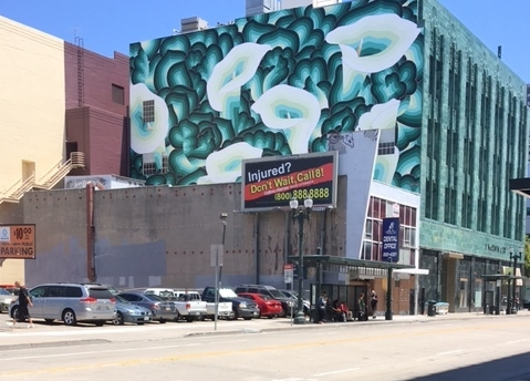 Downtown Oakland in a state of flux.  Public art on old buildings is a sign or a symptom of current gentrification taking place.