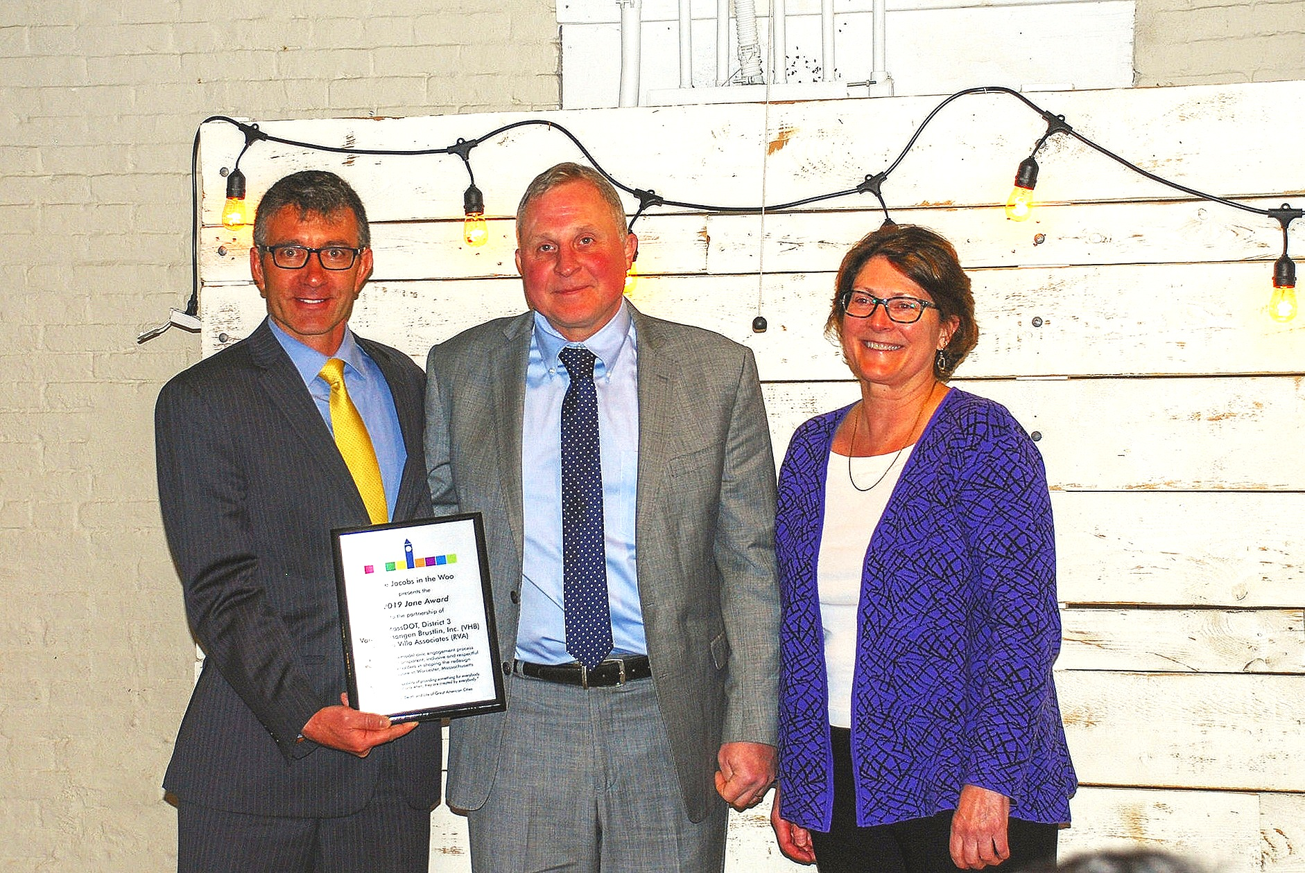 Barry Lorion, District Highway Director of MassDOT, District 3, Don Cooke, Corporate Service Lead from VHB and Kate Barrett, Vice President for Public Involvement from RVA accept the 2019 Jane Award at a ceremony on May 3, 2019 at the White Room, Crompton Place in Worcester, Massachusetts