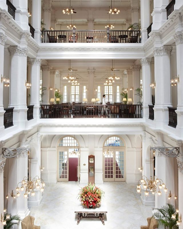 """Singapore's iconic Raffles Hotel is reopening with a modern makeover - """"You have to be respectful of this building and the history this place has,"""" says @alexandrachampalimaud. """"That's where you start, the respect for the hotel … and what it means to Singapore."""" - Managing director Ed Bakos says the Raffles project isn't just about restoring bricks and mortar; it's about strengthening the hotel's social and community fabric. """"When Raffles opened, it was a near beer hall experience, where the community came to the hotel,"""" he says. This fits in with a broader trend of upmarket hotels looking to embrace locals as much as guests. For Raffles, this means redesigning the restaurants, cafes and bars and events spaces to draw in Singapore residents when the renovated hotel relaunches. """"Both the new Writers Bar in the main building and the Tiffin Room will have the ability to spill over at different times of the day to energise what is the centre point of the hotel,"""" explains Bakos. - @financialreview - Learn more about the approach to the reopening by watching Part One, Raffles: Remaking an Icon, documentary link in our bio. - Pictured here is the Raffles' main neo-Renaissance building completed in 1889.  #ChampalimaudProject #ComingSoon #InProgress"""