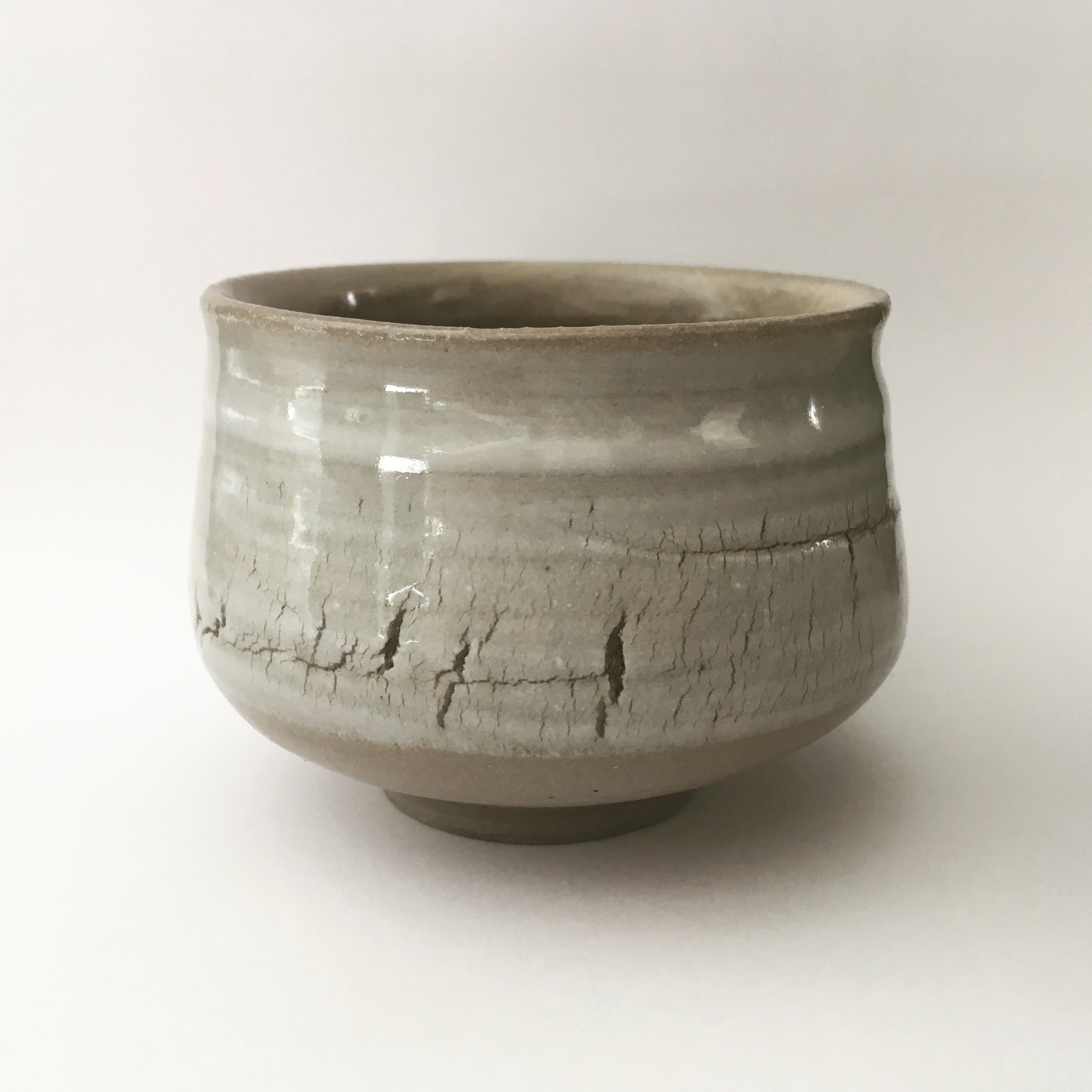 Chawan   Grey stoneware with porcelain crackled slip and transparant glaze.  Ø 7 cm  (Sold)