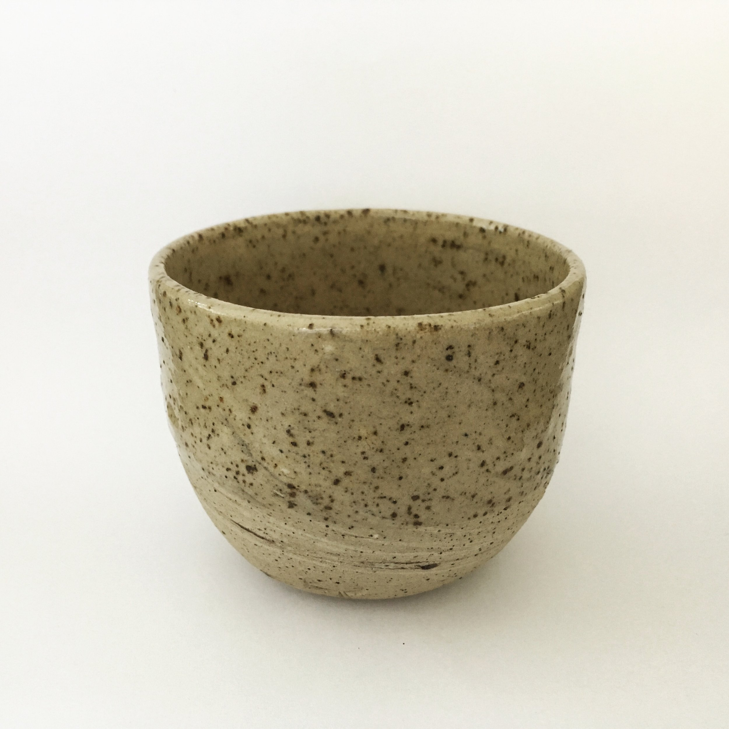 Coffee cup   Unsieved and unwashed local clay from Vimoutiers, FR mixed with stoneware. Transparent glaze.  Ø 7 cm  (Sold)