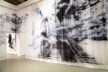 Izhar Patkin,  Veiled Threats,  ink on pleated illusion (tulle curtains), 14 x 22 x 28, 2007, Courtesy of the Artist