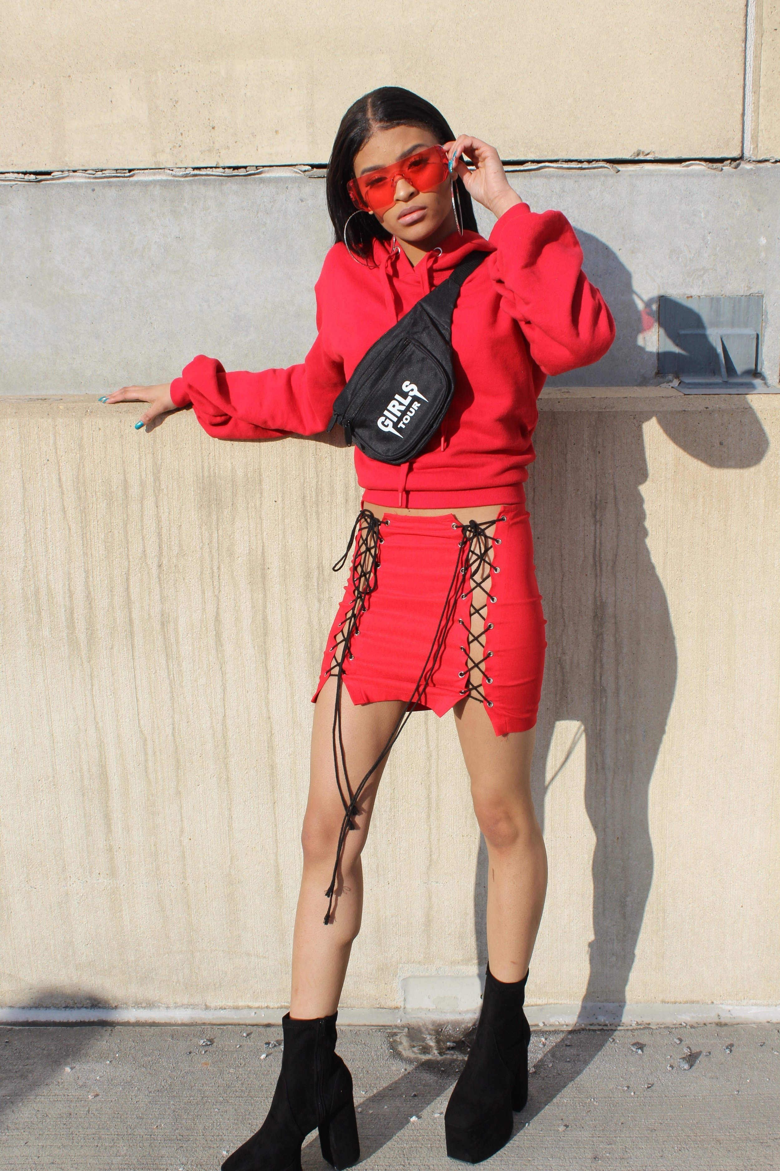 "Destiny wears Gloss 'EDGE"" frame in Red, Sorella boutique fanny pack, target red hoodie, public desire booties, stylist own skirt"