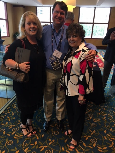 Rhonda Lacy and Sherry Hurt with Colorado Strike Force Captain, Eric Opiela
