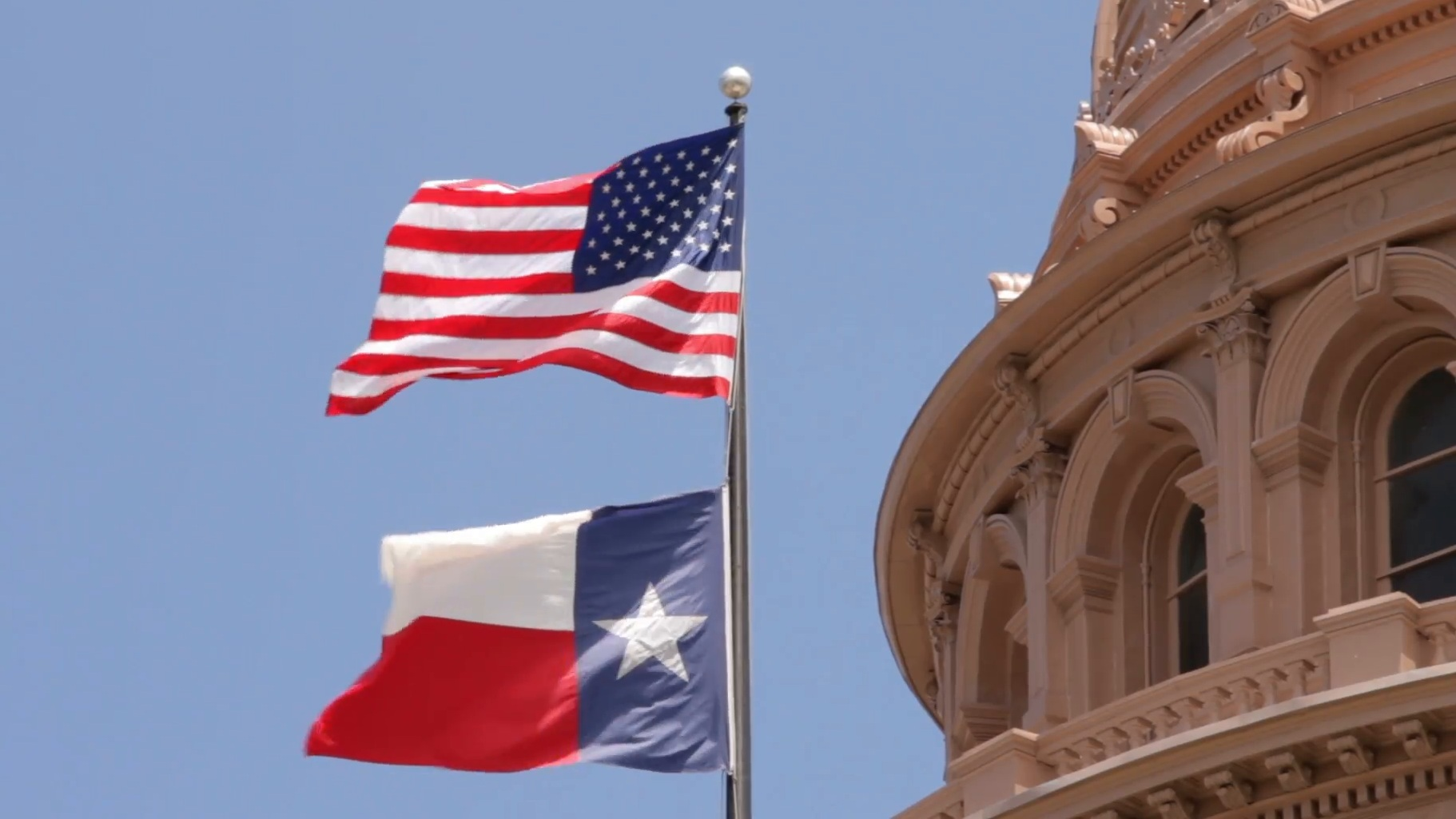 us-and-texas-flags-flying-over-texas-state-capitol-building-austin-usa_n14nhxn3__F0000.jpg