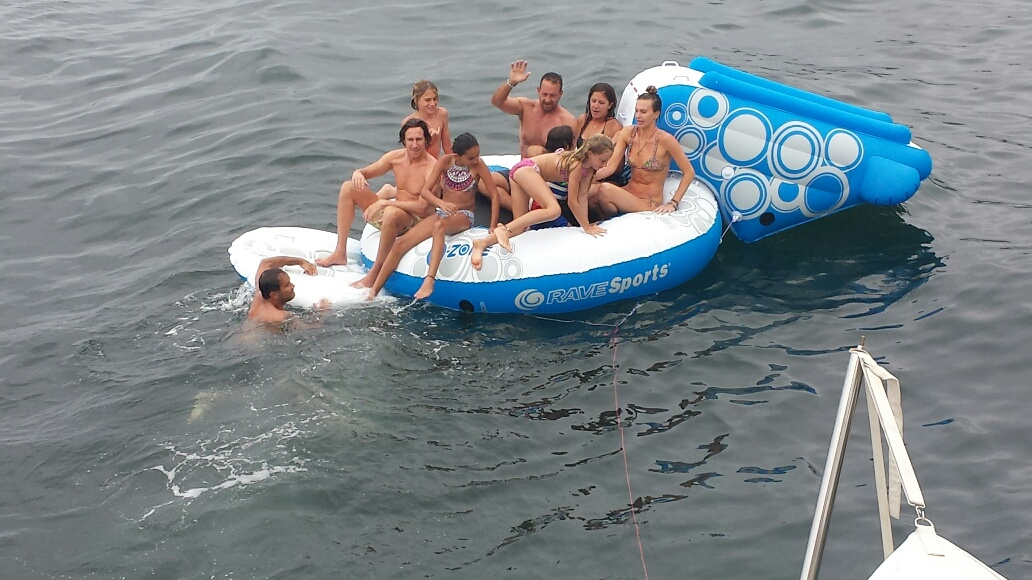 Family and friends on the floating trampoline