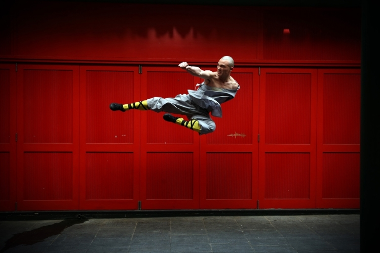 a monk practicing Shaolin Kung Fu, believed to be the oldest institutionalized style of kung fu, by Cal Court - source