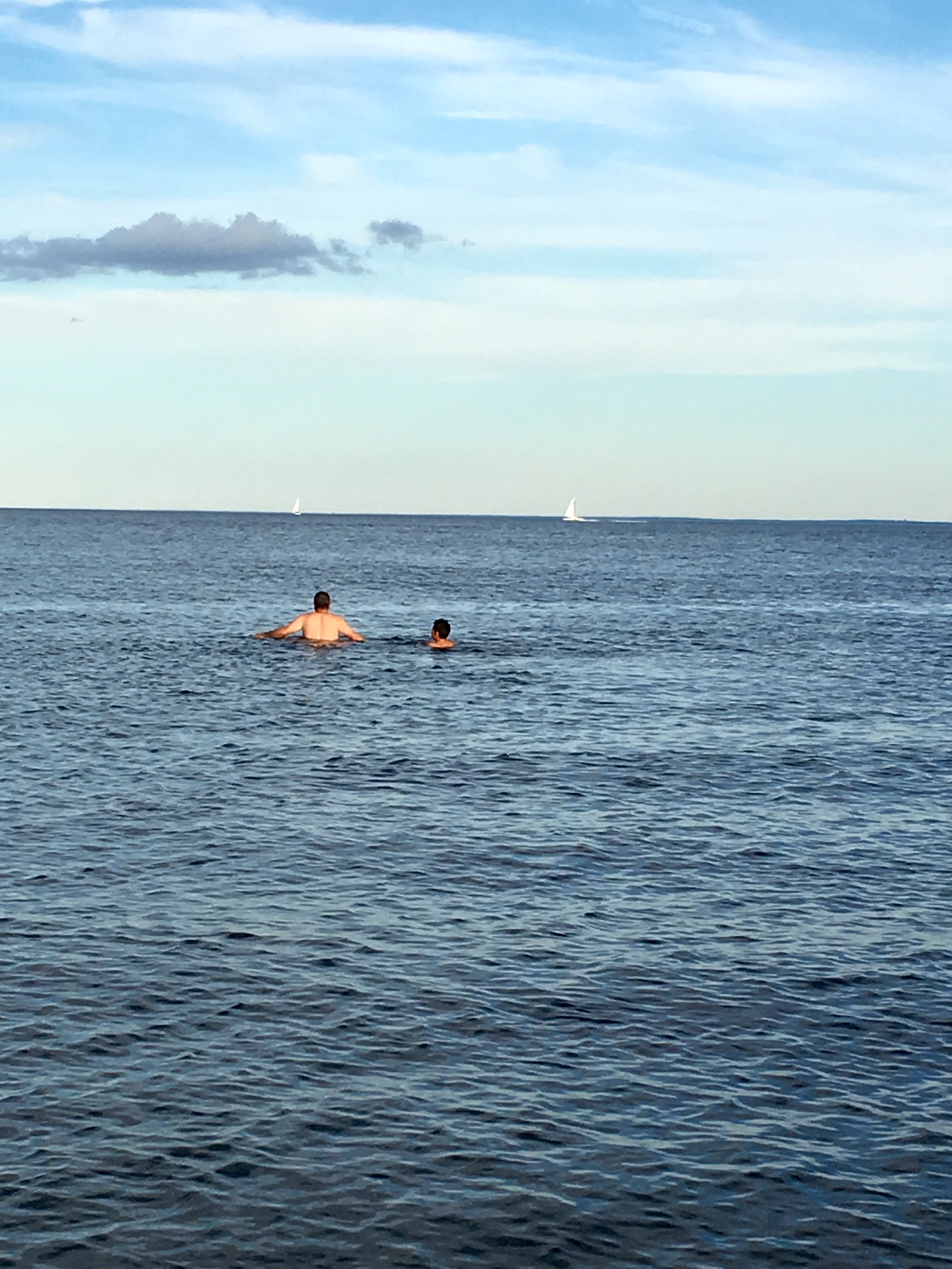 My brother and nephew swimming in the Long Island Sound off Jennings Beach.