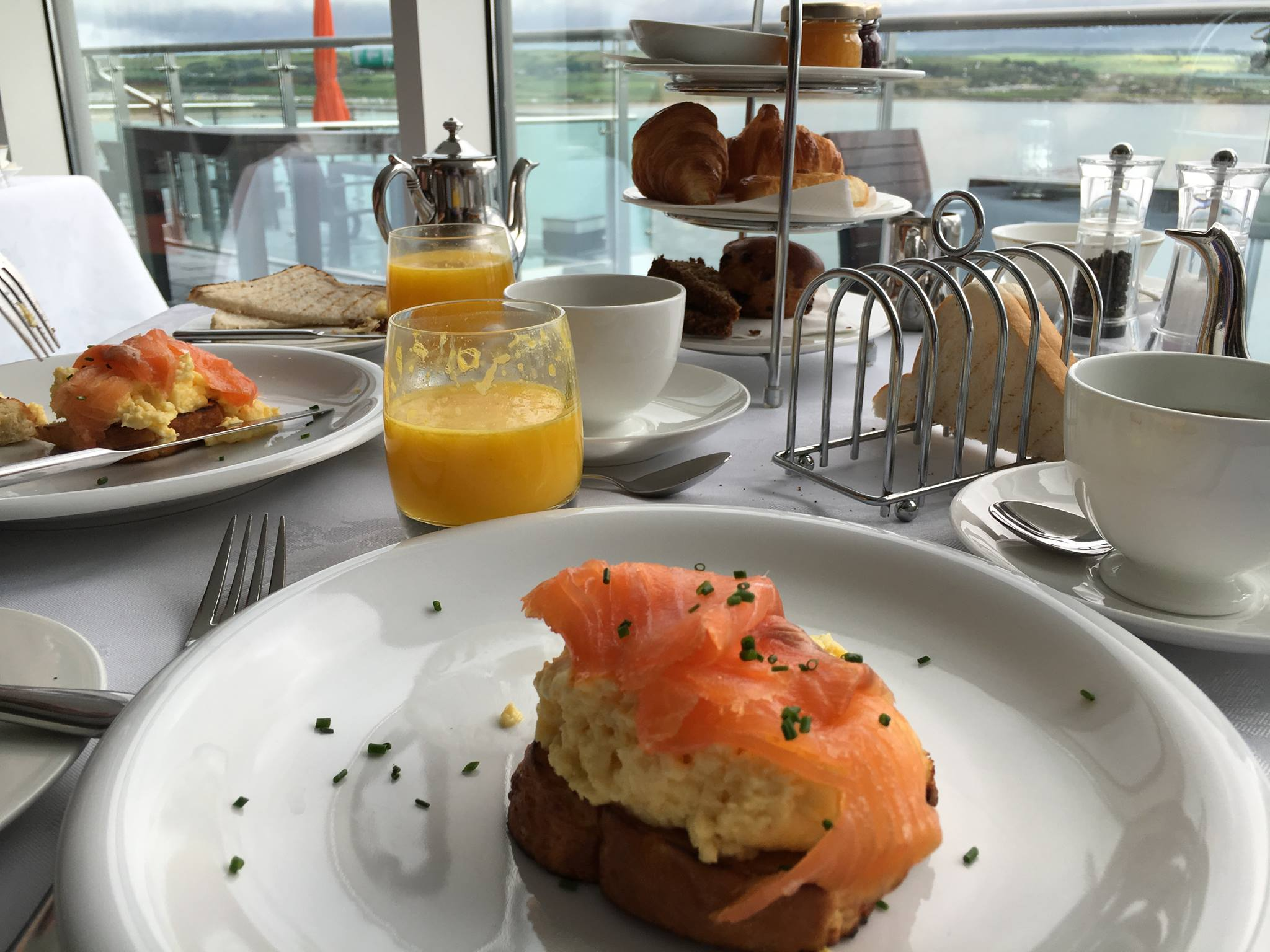 An amazing breakfast - smoked salmon and eggs on Irish toast with freshly-squeezed orange juice and homemade scones - at our splurge hotel in Ireland (Cliff House Hotel, Ardmore, Co. Waterford)