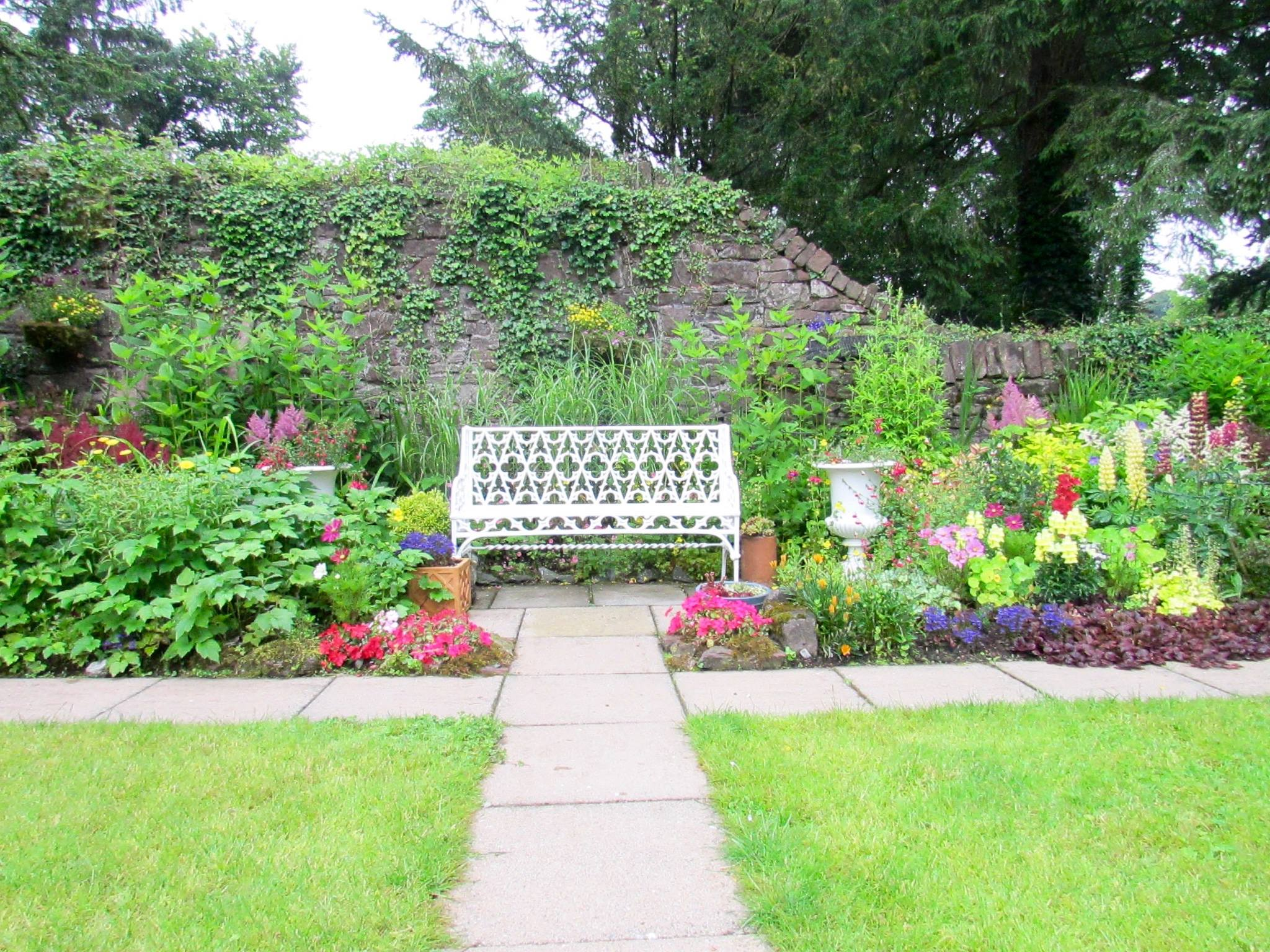 the white bench inside a walled garden where Brian and I prayed each morning for our new church parish