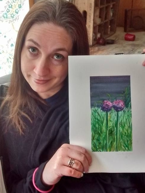 Renee with a painting from a friend