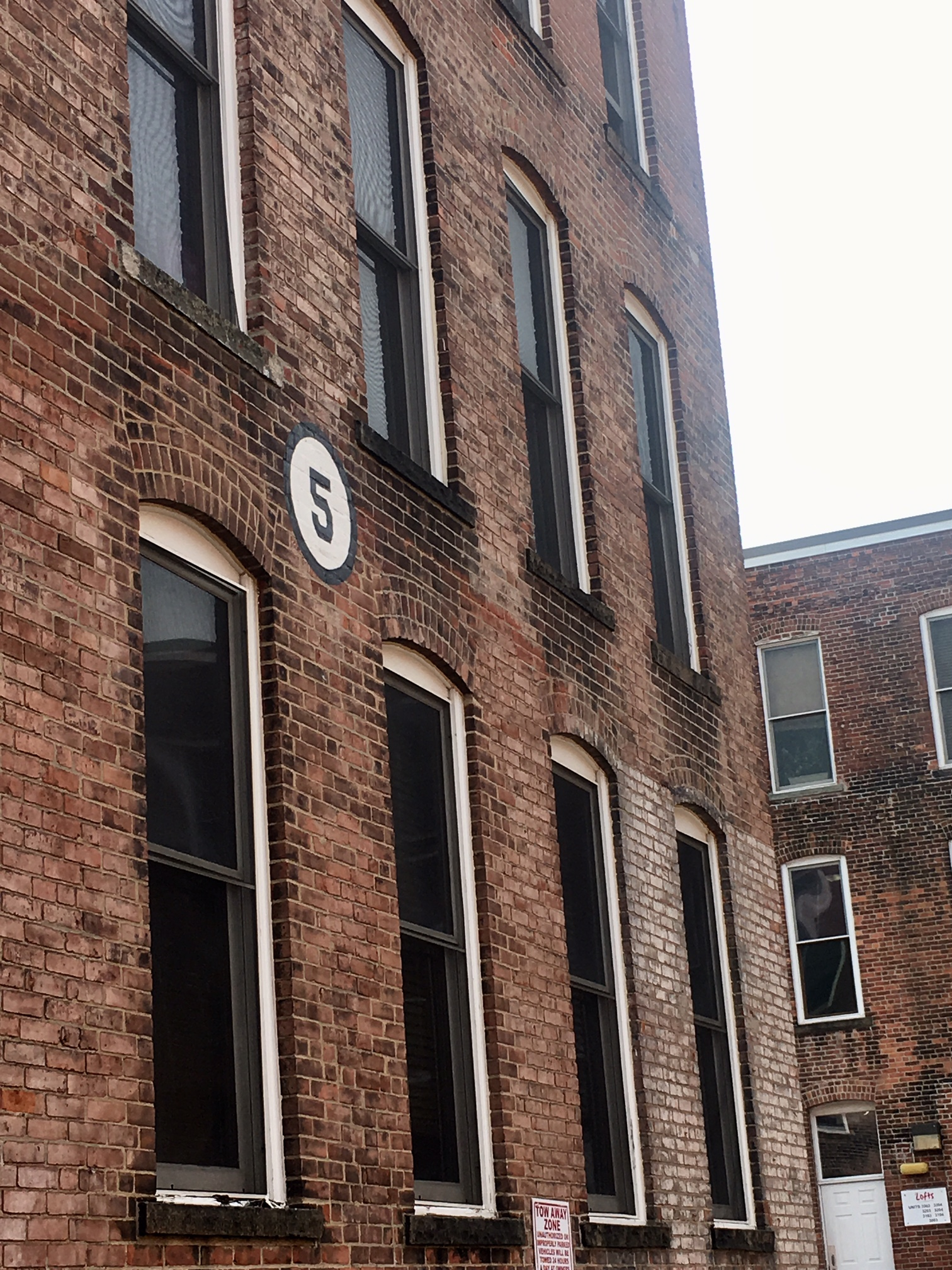 We live in a renovated corset factory. Yes, you read that right. And I love telling people that! The building numbers are my favorite.